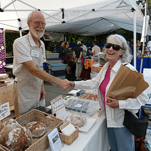 Craig selling bread at the Farmers' Market